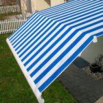 Elegant Marcesa terrassemarkise - Fasadeprodukter AS - med knekk blå